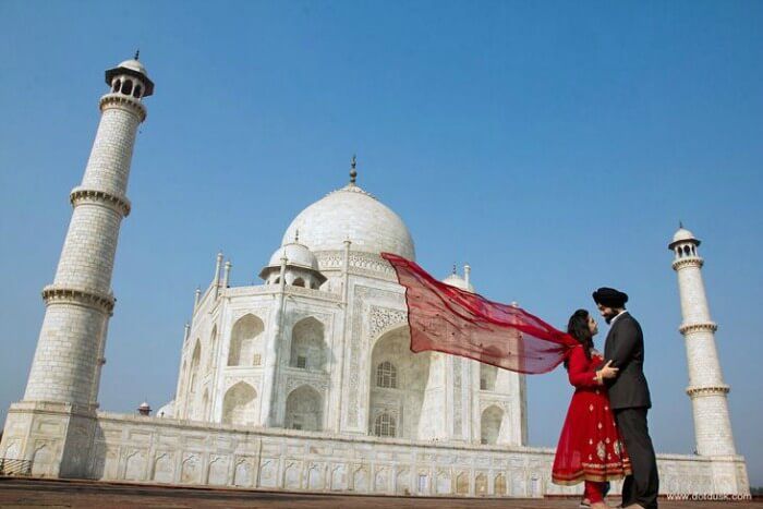 A couple reveling in each other's company at Taj Mahal, one of the best places to go on Valentine's Day