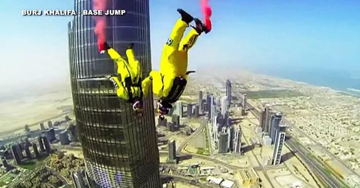 Skydivers base jumping from Burj Khalifa