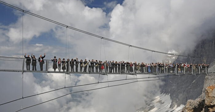 People standing at Austria's Dachstein Stairway - one of the world's most dangerous walkways