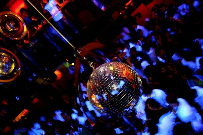 The disco ball and crowd at one of the new year parties in Mumbai