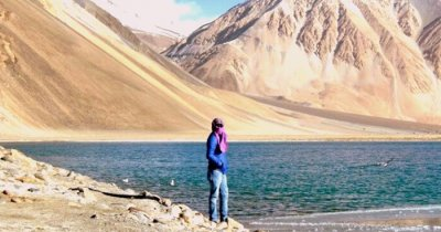Nikhil stands by the lake in Ladakh