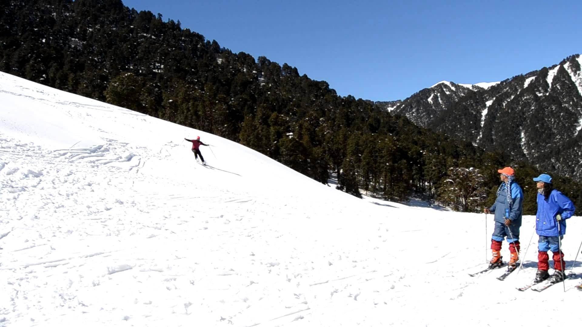 Skiers can be seen enjoying skiing at Dayara Bugyal