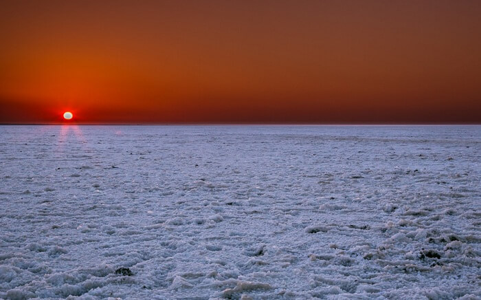 Sunset at the salty marsh lands of Rann of Kutch in Gujarat