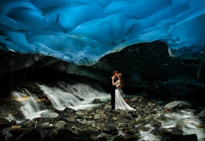 A couple enjoys a kiss at the Mendenhall Ice Cave