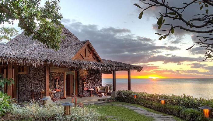 A sunset snap of a hut at the Wakaya Resort