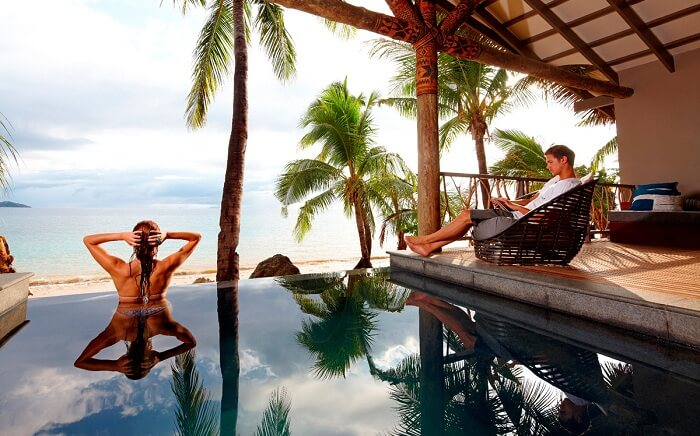 A couple relaxes in a private pool at the Tadrai Island Resort