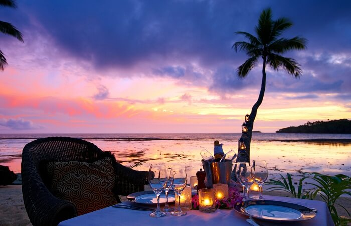 A beachfront dining at the Namale Resort in the backdrop of a beautiful sunset