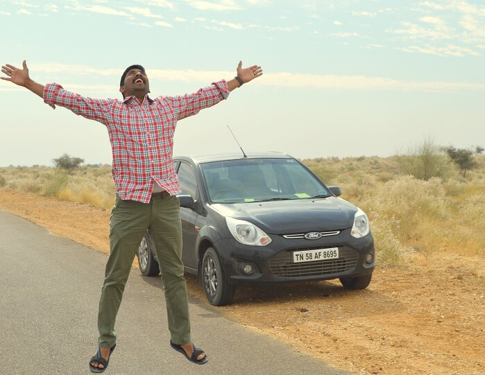Arvind doing a jump on a highway in Rajasthan