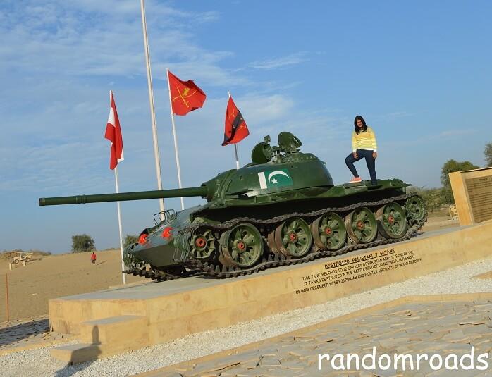 Anusha standing on a Pakistani tank in Longewala