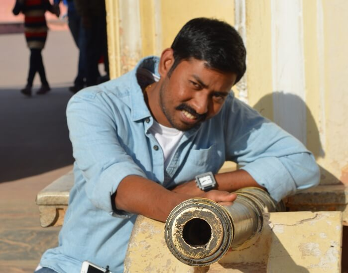 Arvind posing with a small canon in Jaigarh Fort Jaipur
