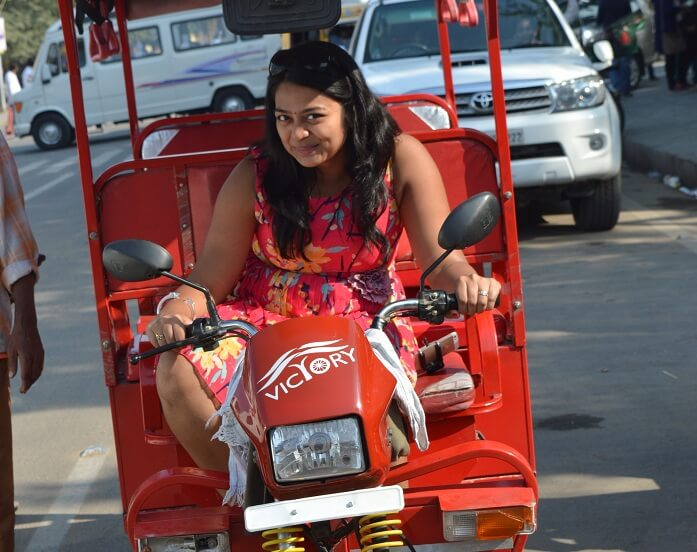 Anusha driving an Erickshaw