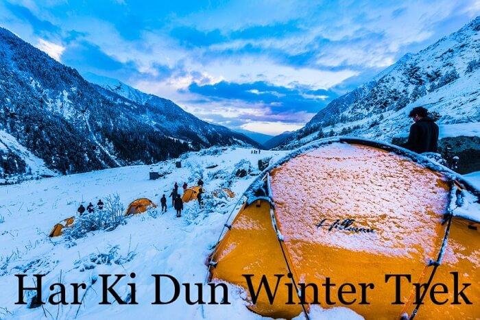 Trekkers rest in tents on the snow carpet on a Har Ki Dun winter trek