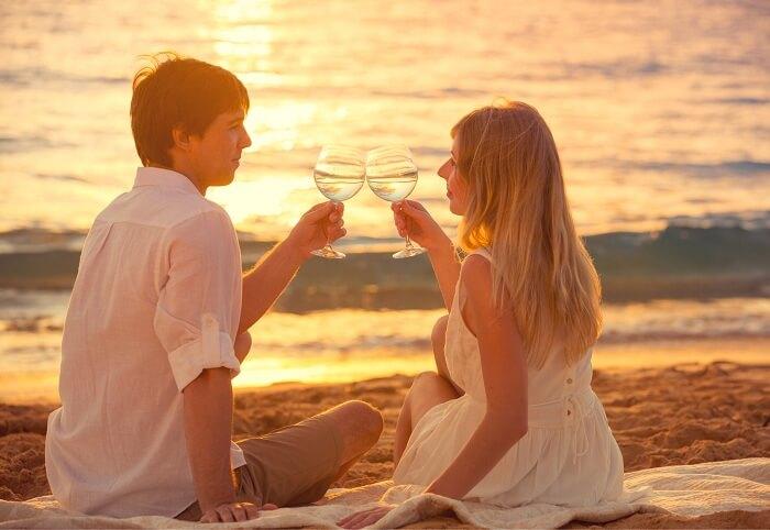 A couple enjoys a sunset at Fiji