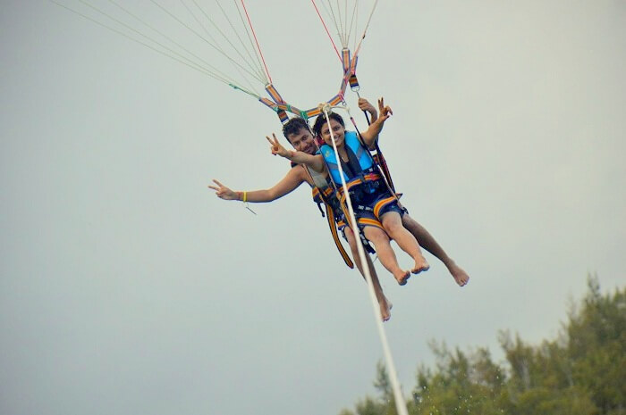 Manuj and his wife doing parasailing in Ile Aux Cerfs Mauritius