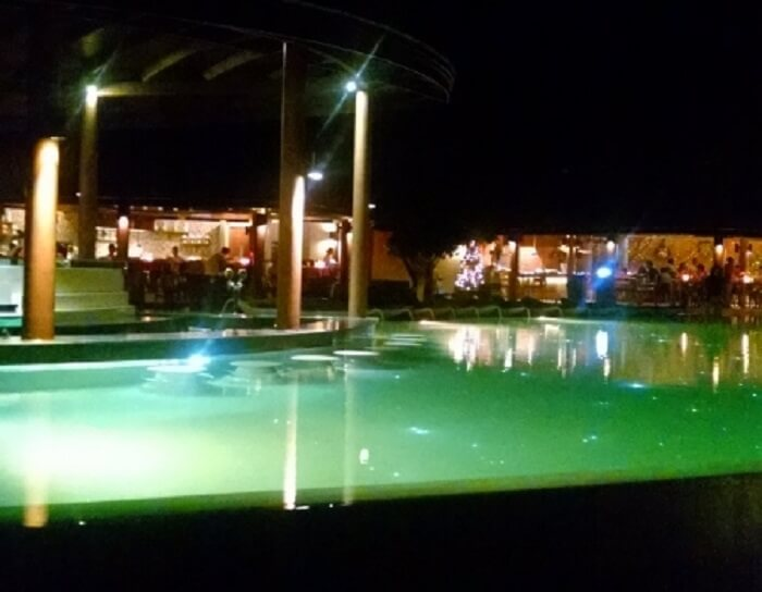 The mesmerising Waves Pool Bar in the night