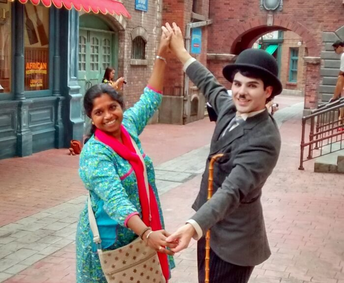 Siva's wife dancing with the made-up Charlie Chaplin