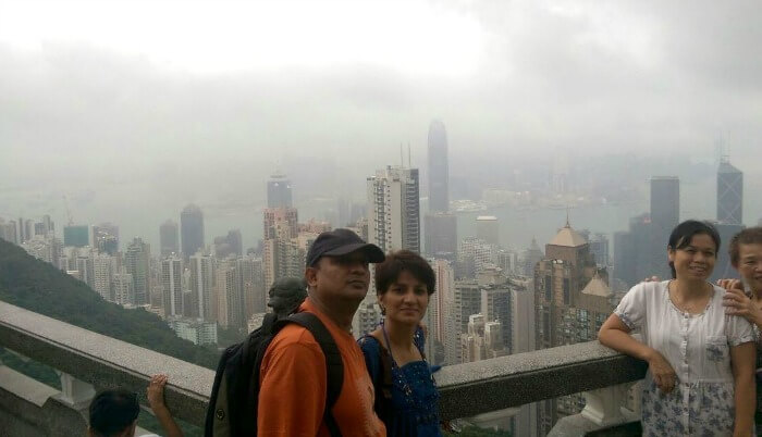Enjoying the stunning view of the city of Hong Kong from the top