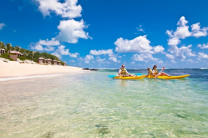 People canoeing at Poste Lafayette Beach in Mauritius