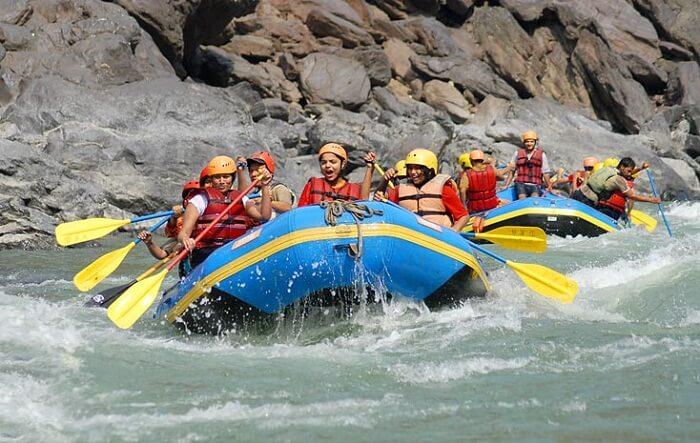 Tourists try white water rafting at Rishikesh