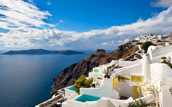 The azure blue water and cute little houses of Santorini make for the best tourist places in Greece