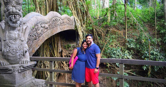 Amit poses with his wife on a honeymoon trip to Bali