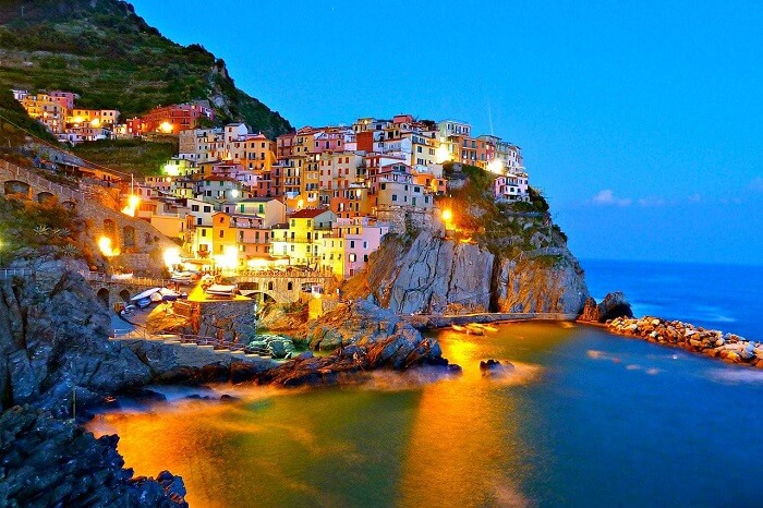 The beautifully lit-up Cinque Terre on an evening