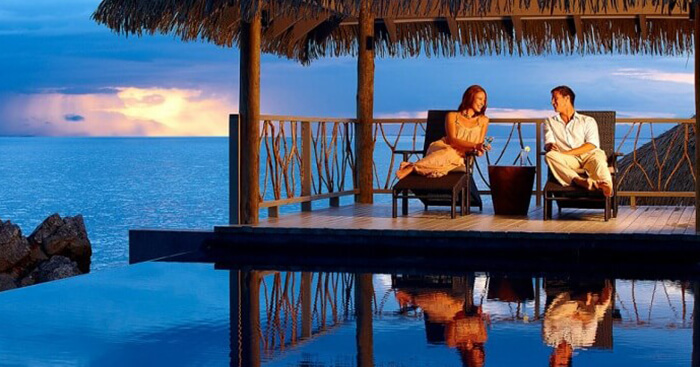 A couple relaxes at the Tadrai Resort in Fiji