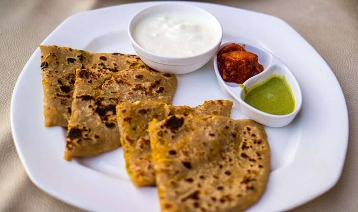 Paranthas served with pickle and curd