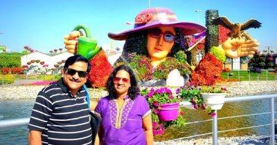 Raman and his wife pose on their family trip to Dubai