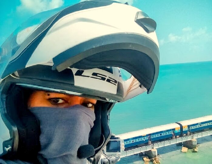 Candida clicking a selfie near the Rameshwaram Pamban Bridge