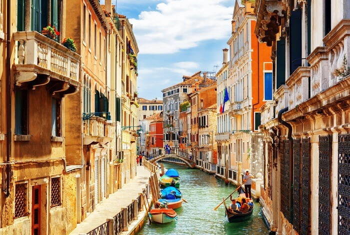 View of the Rio Marin Canal with boats and gondolas from the Ponte de la Bergami in Venice