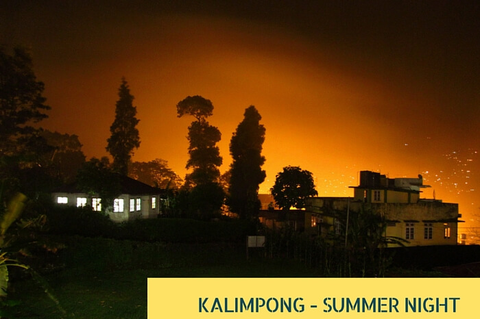 Lights of the guest house create an orange blanket after reflecting from the misty clouds at Kalimpong