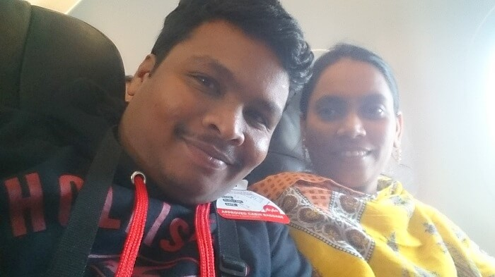 Naveen and his wife click a selfie inside the plane