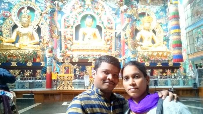 Naveen and his wife in a monastery
