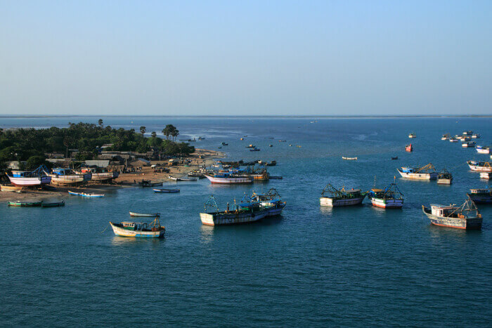 Fishing boats in the sea at a fishing harbor in Rameshwaram