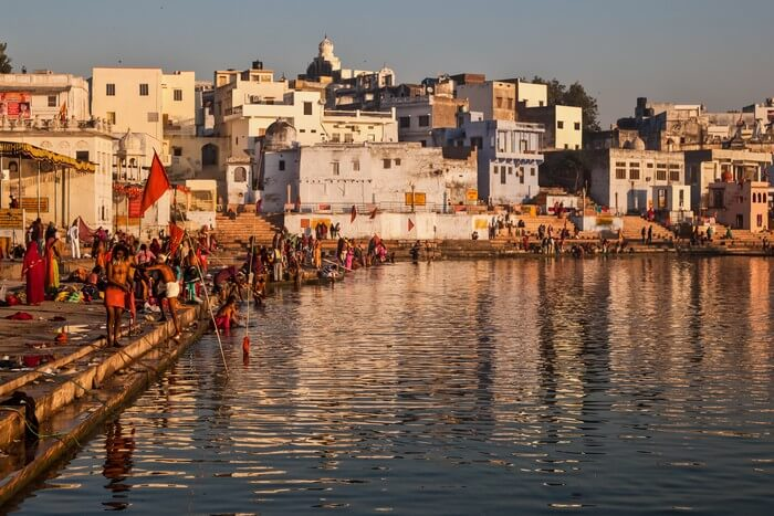 Pilgrims bathing at one of the ghats of Pushkar Lake