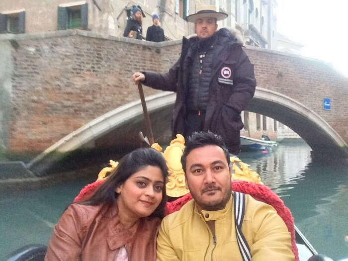 couple enjoying gondola ride in Venice