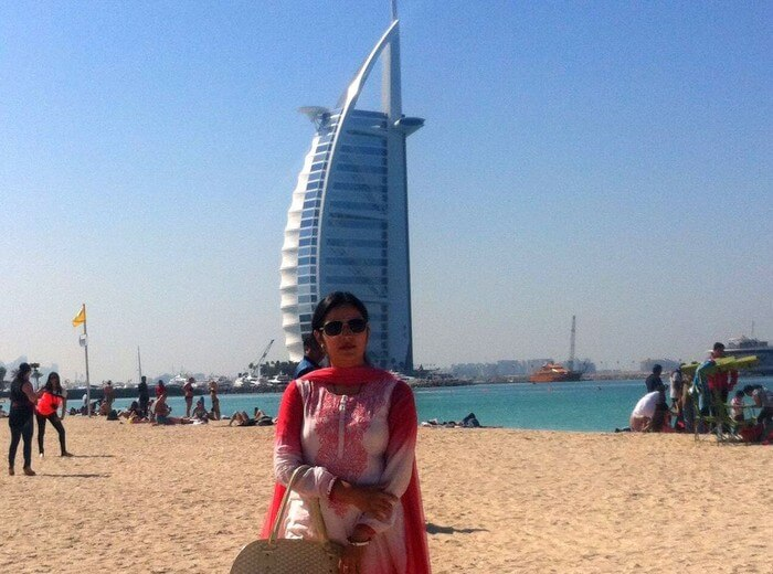 Kapil's wife at the Jumeirah Beach with the Burj-al-arab in the background