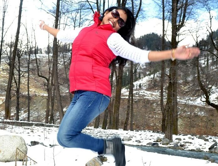 Madhumita jumping with joy in snow
