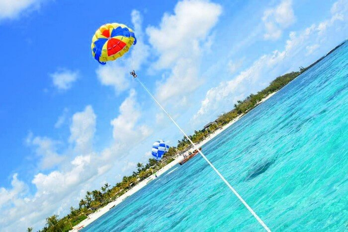 Sandeep and Samatha enjoying parasailing in Mauritius