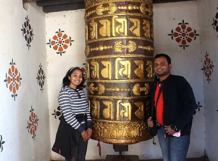 Alpana and her husband in a temple