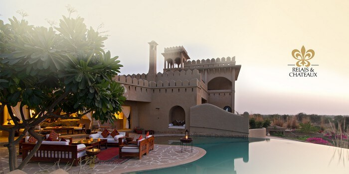 The sitting area by the infinity pool at the Mihir Garh House