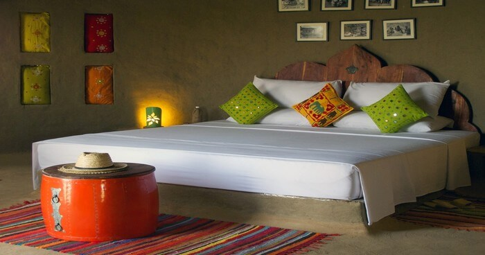 A bedroom in the Lakshman Sagar decorated with ethnic draperies