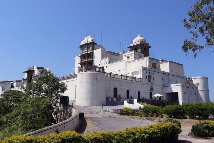 The grand building of Monsoon Palace is perched upon the hills