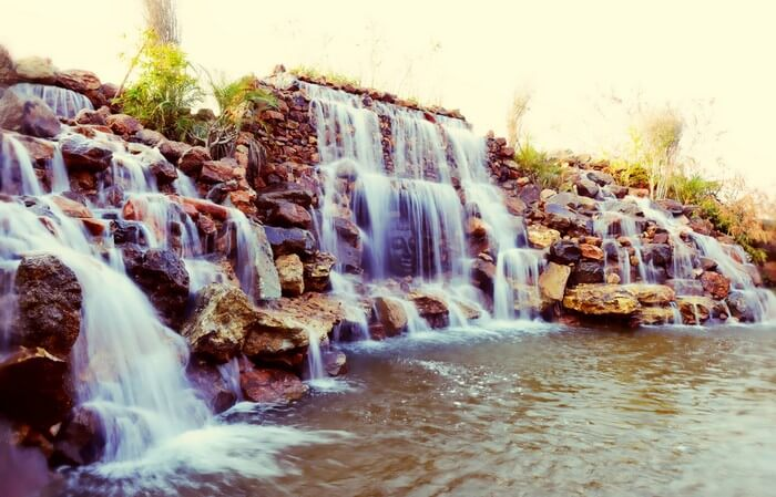 An artificial waterfall at the Water House Resort