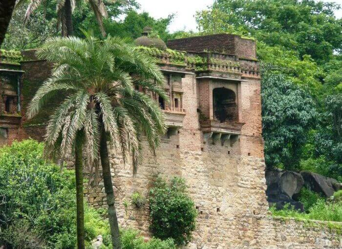 The ruined reminiscent of Achalgarh Fort amidst lush greenery in Mount Abu