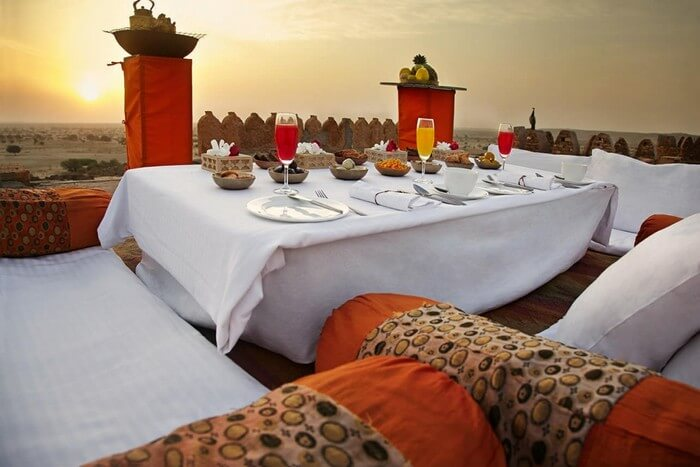 Breakfast on the terrace with a peacock at Citadel in the Thar
