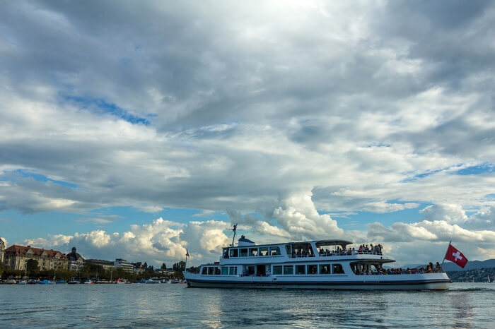 A ferry carrying tourists in the Lake Zurich on a cloudy day
