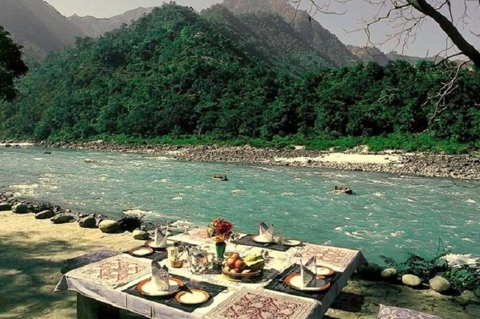 Riverside dining at the Glasshouse-on-Ganges from Neemrana
