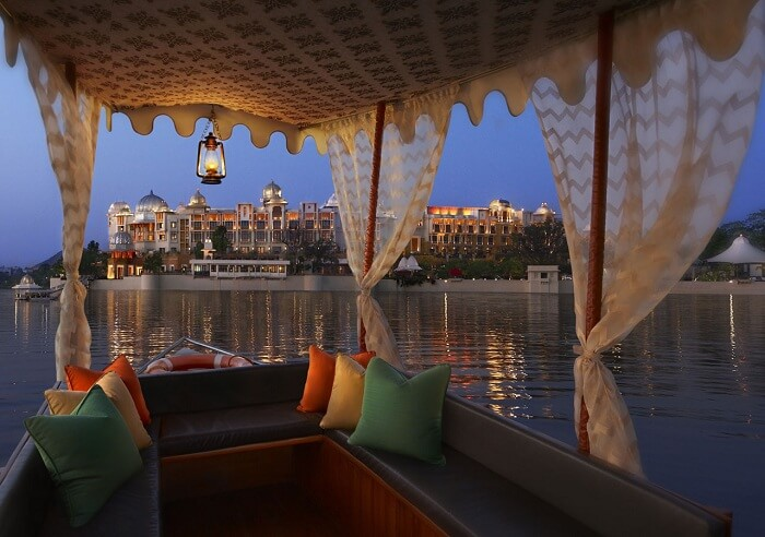 A view of the Leela Palace from a boat in Lake Pichhola